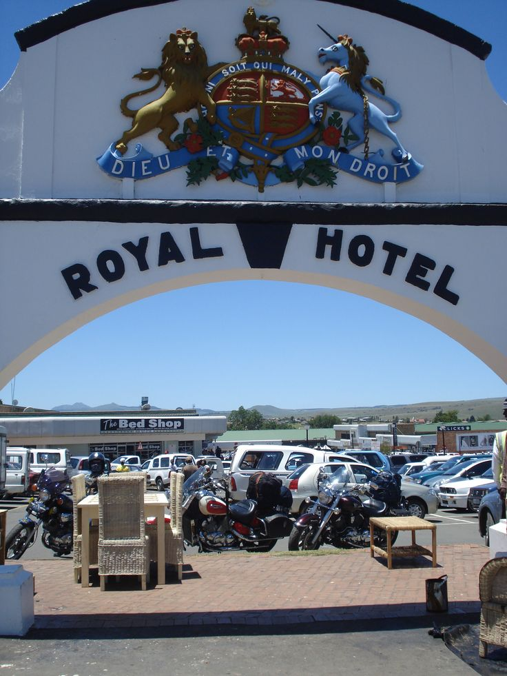 The Dieu Et Mon Droit Coat of Arms supported by an old entrance arch - all that remains of the Kokstad Royal Hotel. Legends tell us that Yankee Wood, an American Negro who helped establish this hotel - ended up years later as its doorman.