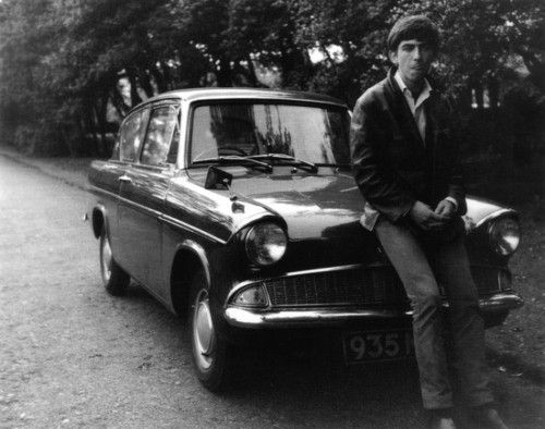 George Harrison in 1962 with his Ford Anglia