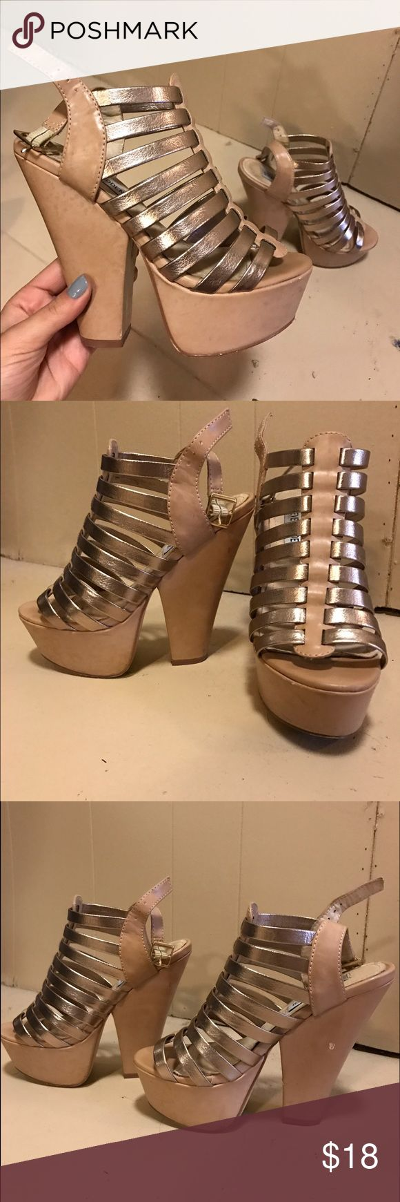 Steve Madden tan and gold wedged heels Super classy tan and gold heels by Steve Madden. Chunky wedge makes them easy to walk in. Worn a handful of times and the wear is shown with some scuffs and bruises. Still great shoes! Steve Madden Shoes Heels