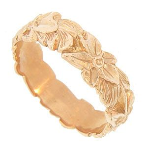 Deeply engraved flowers and leaves adorn the surface of this 14K rose gold antique style wedding band. The brightly polished wedding ring measures 5.50 mm in width. Size 6 3/4. We can re-size slightly.