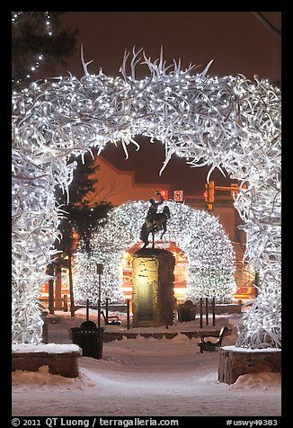 Statue and antler arches by night. Jackson, Wyoming, USA