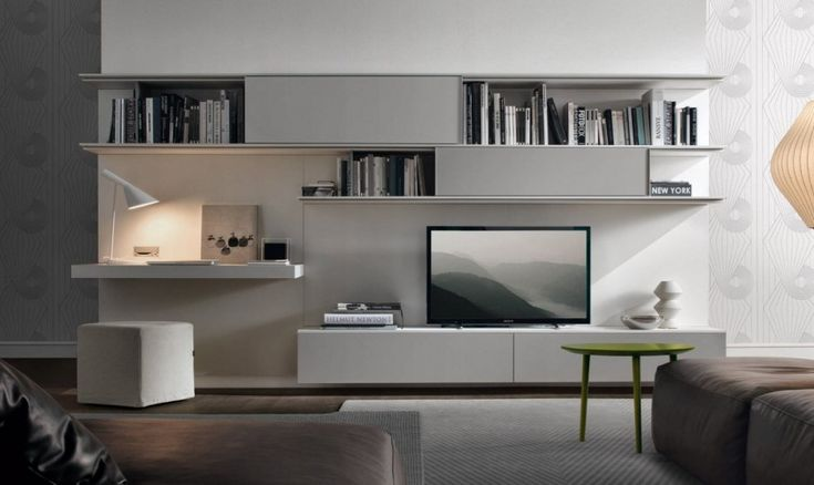 Nice Modern Living Room comes with Long Rectangle Shape Grey Color Book Shelves and Wall Mounted White Computer Table