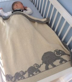 Knitting Pattern for Elephant Family Baby Blanket - Finished size of the blanket: 85 x 80 cm (93 * 87 inches). Pattern is in English and French. Designed by Mathilde R