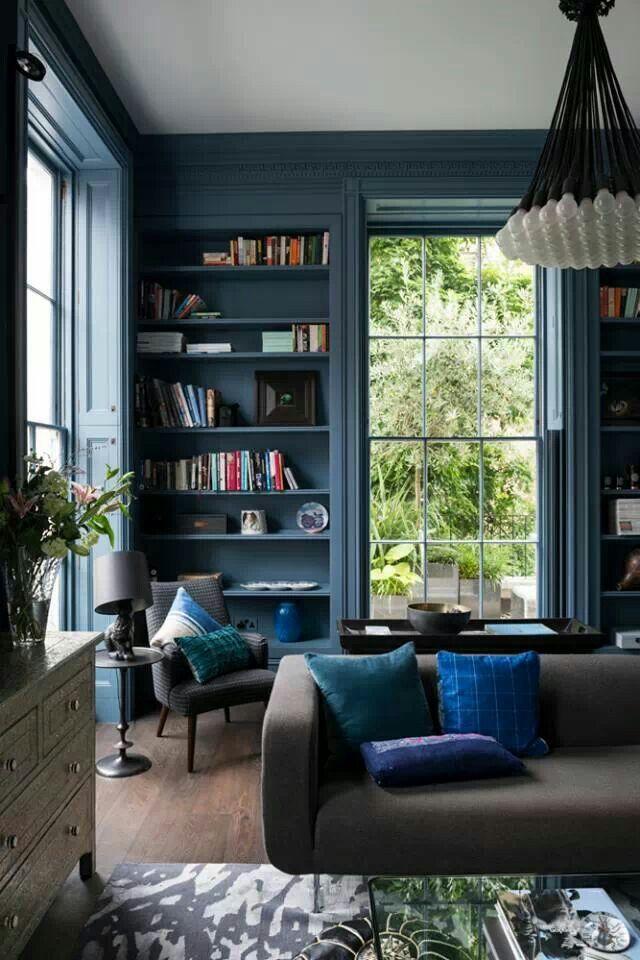 Lobby, rich, bookshelves, trim detail, modern lighting
