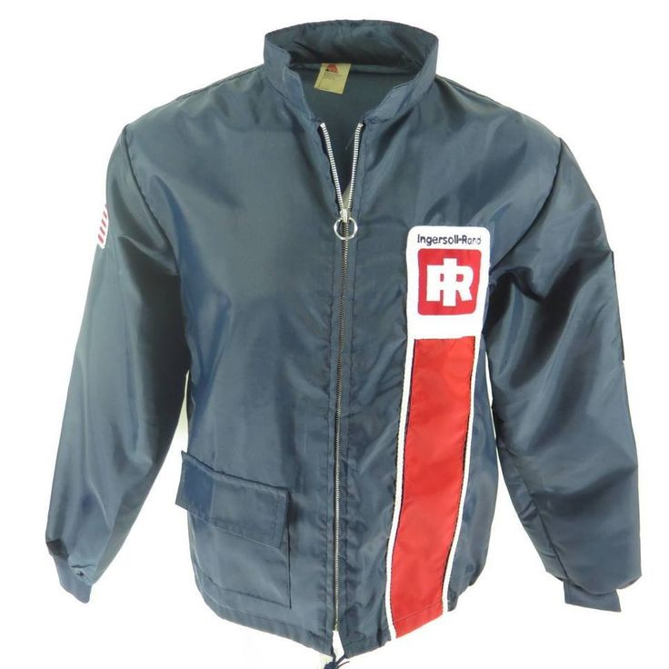 <p>This is an awesome vintage 1970s pit windbreaker jacket for the Ingersoll-Rand Racing team. It has all the qualities of a racing team jacket like the iconic racing stripes and a racing team and American flag patches on the shoulders. The best part is that it is in new old stock, deadstock condition!</p>