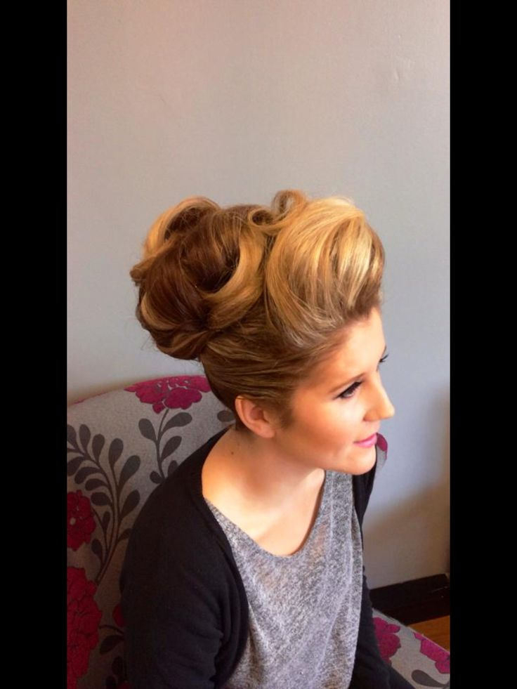 An elegant bun inspired updo with bump at front. A more polished upstyle but a perfect wedding upstyle