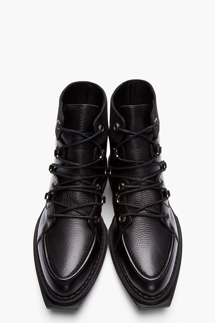MCQ ALEXANDER MCQUEEN //  Black Leather Lace-up Lipp Boots  32114M047002  High-top leather boots in black with contrasting matte and textured finishes. Almond toe. Tonal lace up closure with gunmetal tone eyelets. Paneled upper. Squared welt at toe. Thick rubber foxing in black. Tonal stitching. Leather upper, rubber sole. Made in Italy.