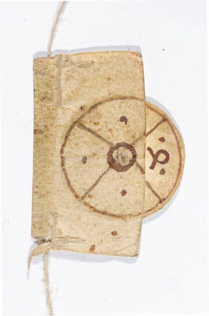 """""""Rotating bookmarks were a special kind of bookmark used in medieval Europe. They were attached to a string, along which a marker could be slid up and down to mark a precise level on the page. Attached to the marker was a rotating disk that could indicate the column (usually numbered one to four, indicating the two columns on the left-hand page, and the two columns on the right-hand page)."""""""