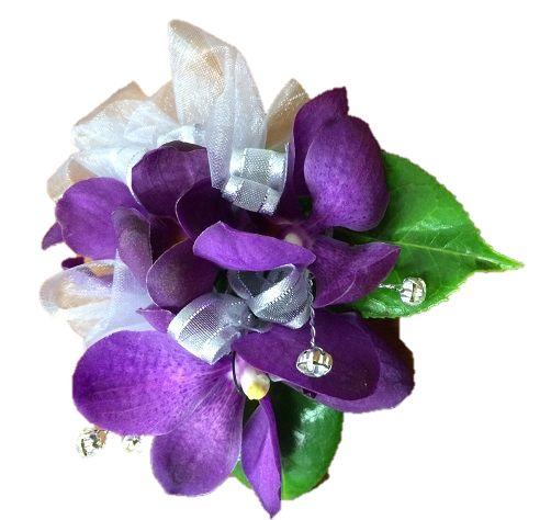 Wrist corsage - purple orchids   https://bloominboxes.com.au/wrist-corsages-school-balls-purple