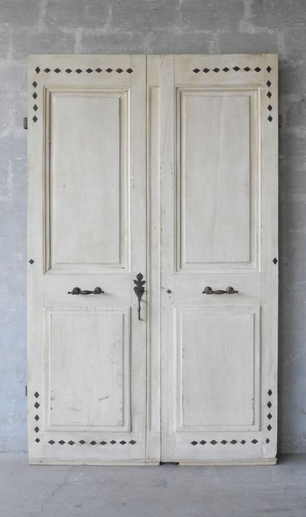 This pair of reclaimed french doors have stood sentry at a for European french doors