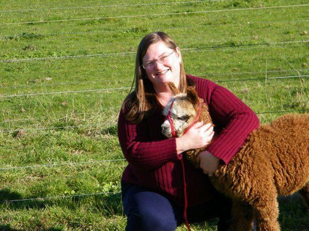 """Angela with """"Milo"""" the baby alpaca"""