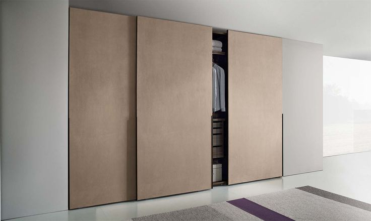 The Hopus sliding door wardrobe has distinctive upholstered doors which are available in either fabric or Econabuk leather.�