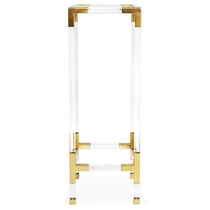 Transparent Lucite furniture is unimpeachably chic but not visually overwhelming. Featuring the Jonathan Adler Jacques Pedestal