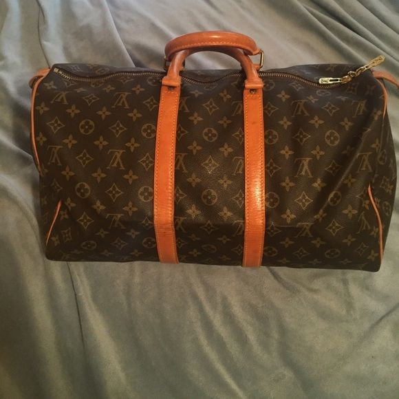 Final Price! Authentic Louis Vuitton Keepall 45 Keepall 45. In good used condition. No holes or rips. Some water stains on the straps Louis Vuitton Bags Travel Bags