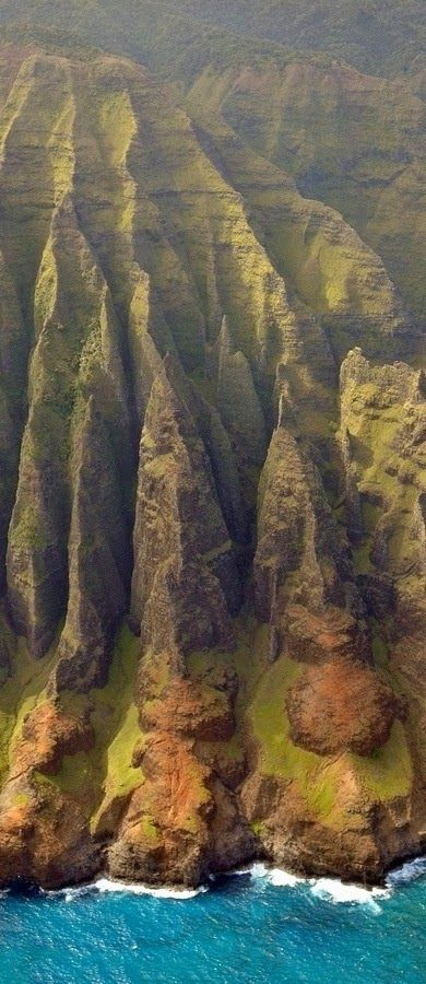 Nā Pali Coast - Kauai, Hawaii. The Napali Coast is a breathtaking coastal range that can only be accessed by hiking, sea tour or helicopter tour. Much of Na Pali Coast is inaccessible due to its characteristic sheer cliffs that drop straight down, thousands of feet into the ocean. The pali, or cliffs, provide a rugged grandeur of deep, narrow valleys ending abruptly at the sea.