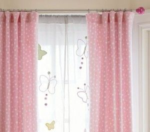 Girls room - sheer curtain with butterflies under purple curtains.
