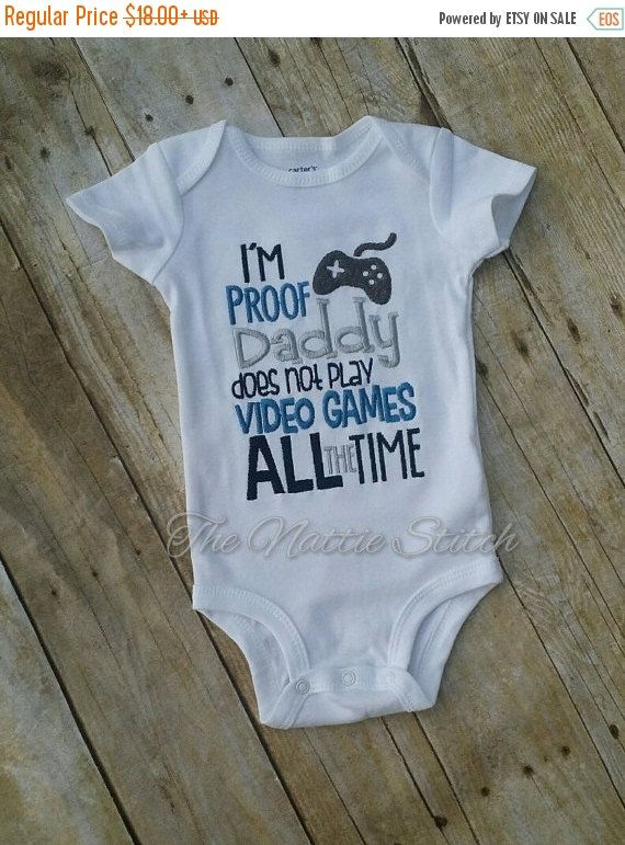 This listing is for (1) Embroidered Onesie/Shirt that reads: Im Proof Daddy does not play video games all the time.  The shirt can be worn on many different occasions, such as: Fathers Day, New Baby Going Home Onesie, Everyday Wear, or even a Pregnancy Announcement.   Onesie Sizes: Newborn - Infant 18 months Shirt Sizes : 6 months, 12 months - Girl 10, Boy 8  If you would like a different color option please simply leave me a note during checkout.  **The current turn around time for apparel…