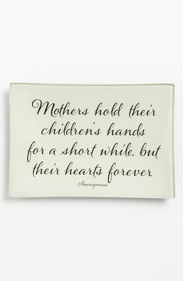 Mothers hold their children's hands for a short while, but their hearts forever.