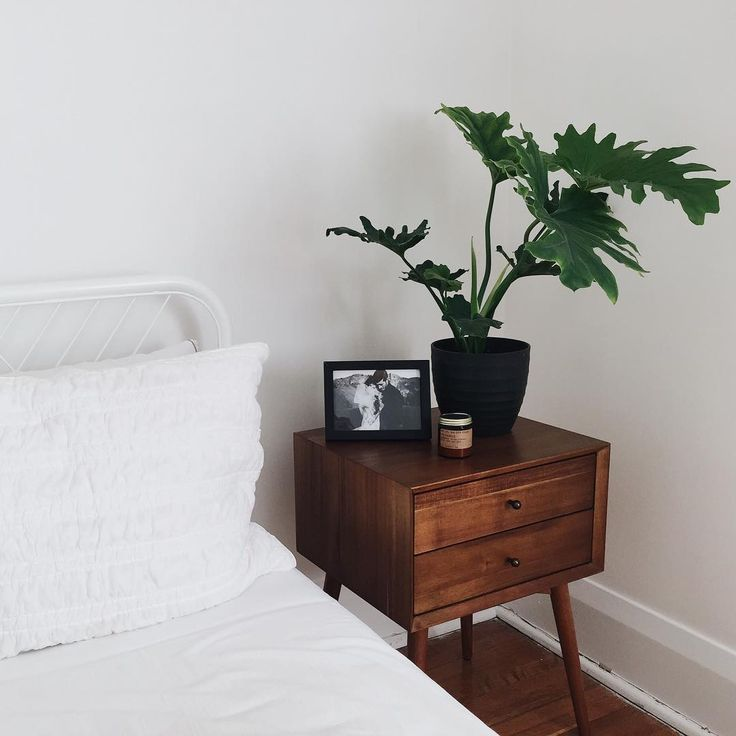 West Elm walnut bedside table in minimalist white bedroom