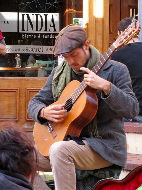 Guitarist, Cuba Street, Wellington, NZ    From: http://www.dangerous-business.com