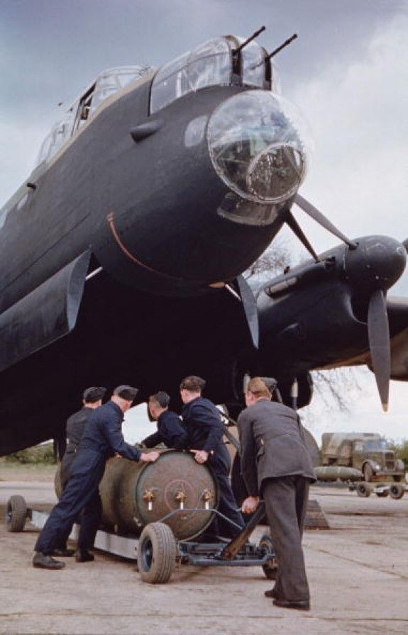 Troops loading a 400lb 'Cookie' bomb into a Lancaster bomber.
