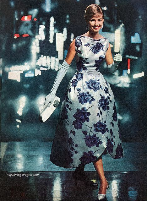 1957-1950's fashion. dress over knees without sleeve and long gloves. cobalt blue flower detail on fabric and white beautiful clutch