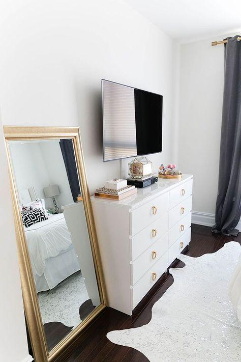 Gold full length mirror & minimal black & white bedroom styling