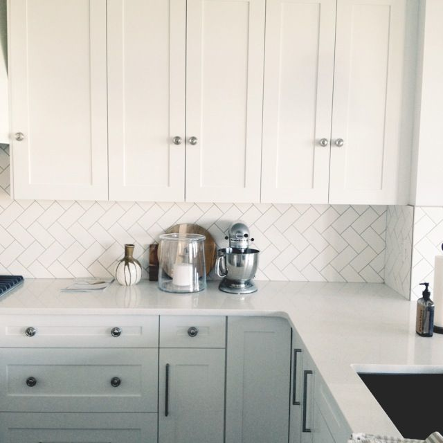 herringbone tile backsplash + white cabinets