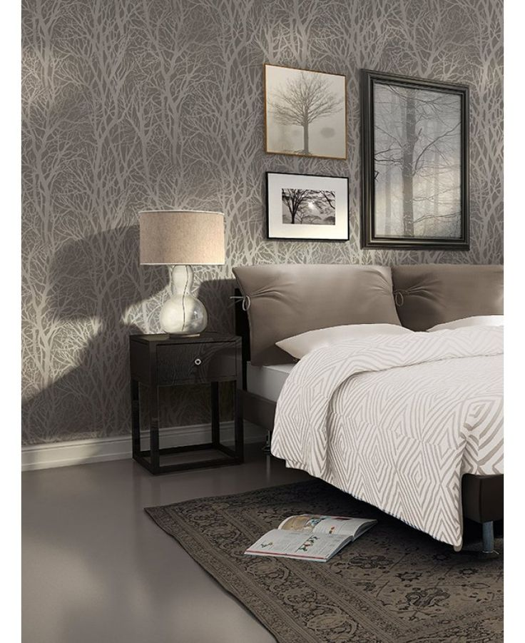 This beautiful Tree Branches Wallpaper would make a great feature in any room. It features a soft matte paper in dark grey with an intricate cut out tree branch design that reveals a metallic silver finish underneath.