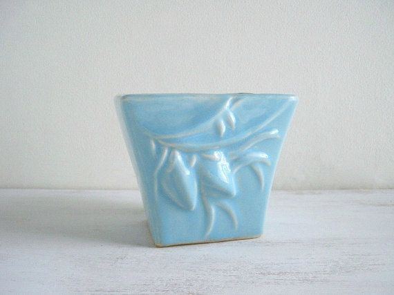 Vintage Blue McCoy Pottery Vase Planter Pretty pottery vase or planter in a wonderful light blue. This vintage blue pottery vase or planter was made by McCoy, c. 1950. The square vase features pretty embossed flowering branches on the front and back. It is marked McCoy on the bottom. Very good condition with no chips, cracks or crazing.    Measurements:  4-3/4 wide by 4 deep by 4 tall    Check out the shop for more great vintage finds:    http://www.etsy.com/shop/Gold...