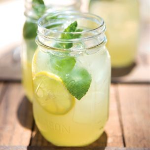Sparkling Mint Lemonade  1 cup fresh mint leaves, plus more for garnish    8 fl. oz. simple syrup (to make 3 oz. mix 1/4 c superfine sugar and 1/4 hot water till dissolved)    1 cup fresh lemon juice    6 cups cold water    Ice, as needed    2 cups sparkling water    Lemon wheels for garnish      Mix syrup with mint leaves, then add in the rest. Makes 12 drinks.