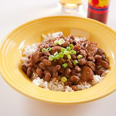 Red Beans and Rice by Cook's Illustrated -- To replicate this traditional red beans and rice recipe from New Orleans using ingredients easily found in supermarkets across the country, we made some simple substitutions: small red beans for Camellia-brand dried red beans and bacon for hard-to-find tasso.