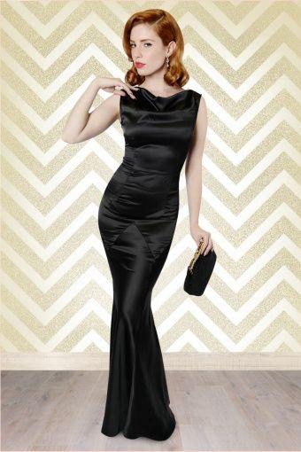 Deze schitterende nauw aansluitende jurk is geïnspireerd op de avondjurken uit de jaren '30 en heeft klassieke diamantvormige inzetten op de heup. De elegante hooggesloten halslijn loopt door in een sexy diepe V op de rug, vavavoom! De prachtige mermaid style rok geeft je dat felbegeerde zandloper figuur en komt bij een lengte van 1,70 m tot net aan de grond.