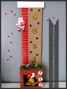 - Calendrier de l'avent pour cette année 2015 , création réalisé ce week end par nounou, pour le moment le père noel attend tout en haut de la cheminée mais il ne va pas tarder a descendre chaque jour qui passe pour finir dans la cheminée ! - pour commencer...