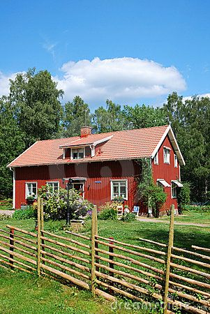 Red Swedish house in the middle of nature.