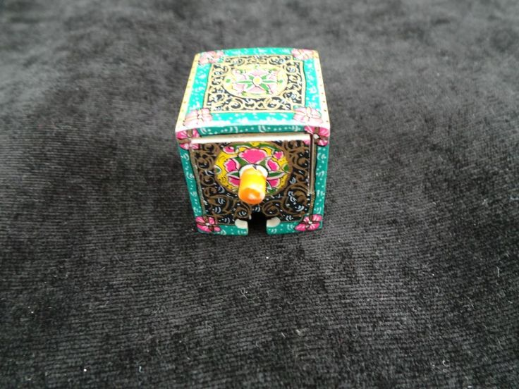 Item Details: Size: 3cm X 3cm X 3cm (WXDXH) W=Width, D=Depth, H=Height  Weight: 40 gr  Material (s): Glazed Hand Painting on Camel Bone  Origination: Handmade in Isfahan / Persia (Iran)  Usage: Jewelry Box , Small Storage, Decorative Item, Persian Gift Item  Shop @  http://persianhandicrafts.com/miniature-hand-painted-jewelry-box-hm1002-persian-handicrafts-and-souvenirs.html/