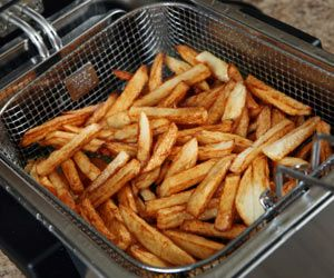 How to clean a fry daddy.  Make a paste from baking soda and water. Scrub in circles with a cloth or scrub brush. Rinse with water!