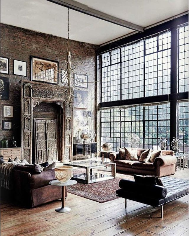 An almost haunting industrial living room uses vintage touches to create a totally unique experience