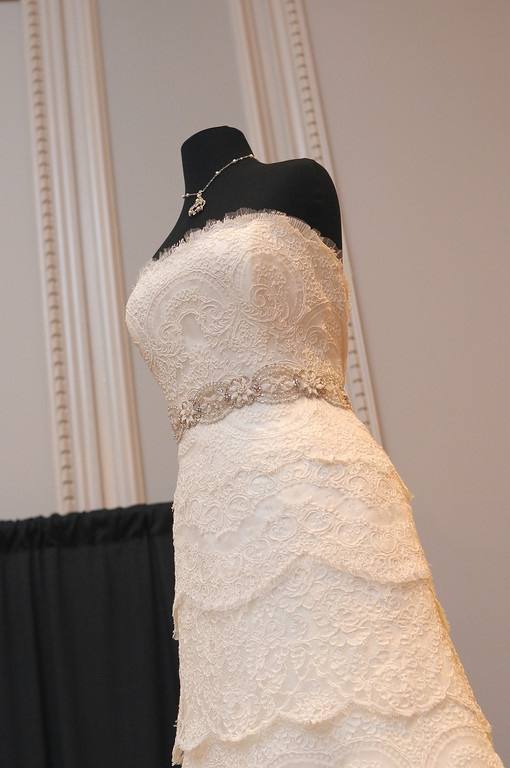 White and Gold Wedding. Sweetheart Neckline, Lace Trumpet Wedding Dress. Beautiful tiered lace gown by Rivini
