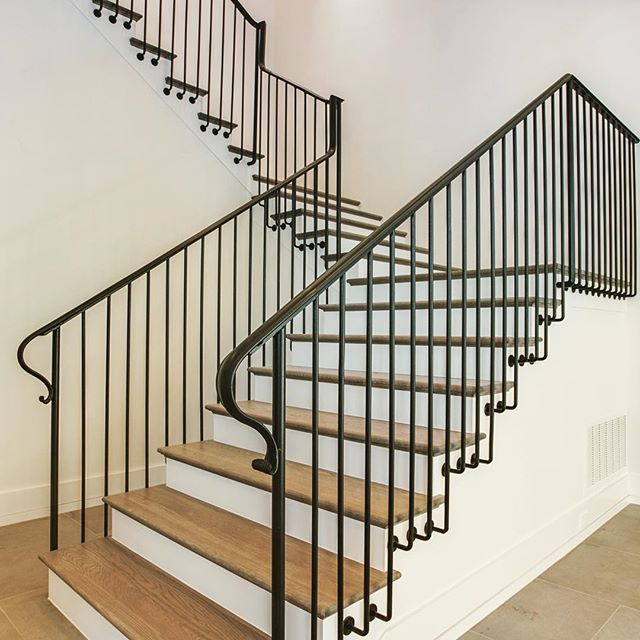 This simple iron railing on these #stairs makes a ...