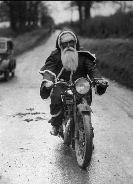 Reindeer's are in for their annual service. santa | motorbike | black & white | santa suit | christmas | vintage | road bike | bike | christmas | holiday season | presents | santa sleigh | Saint Nicholas