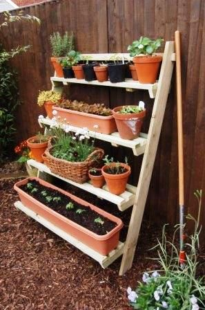 Grow your garden using little space. Cute for a little herb garden with floral accents.