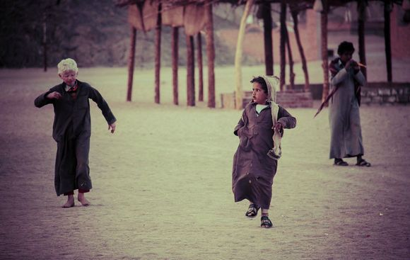 Bedouin boy running