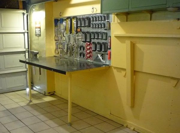 Fold down garage bench nice way to save floor space if needed projects to try pinterest - Space saving garage shelves ideas must have ...