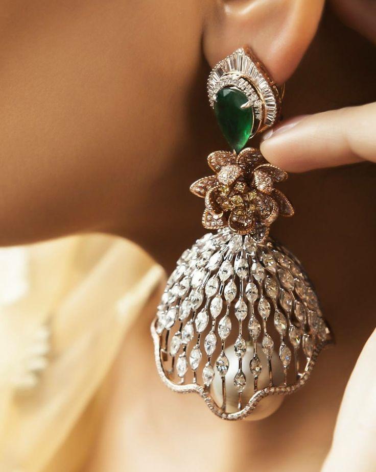 Awesome design. Diamond jhumkas in interesting design