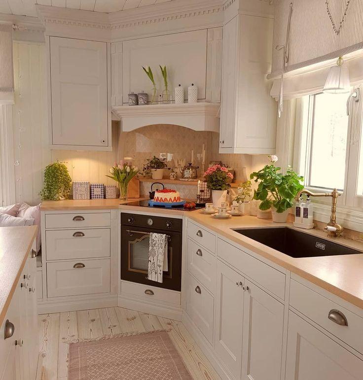 Wood countertops add roughness in a modern farmhou…