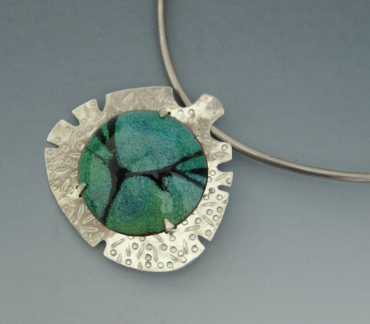 pendant,sterling silver,stamped back plate,tab set torch fired enamel,stencil.