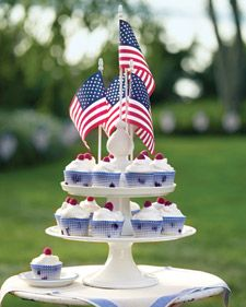 Berry Cupcakes  Pledge allegiance to the cupcake via a cake-stand monument crowned with flags.