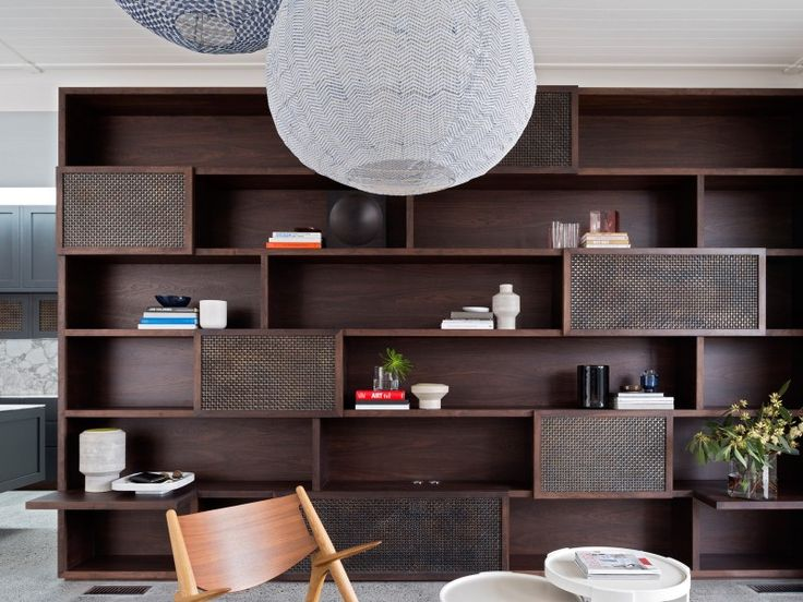 Luigi Rosselli Architects | Balancing Home | dark stained walnut storage unit…