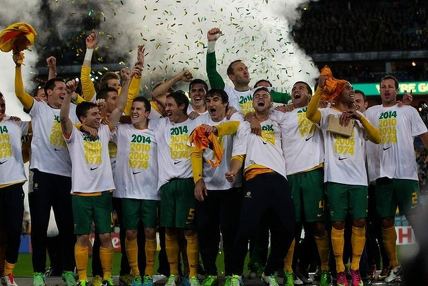 The Socceroos celebrate after defeating Iraq at the Olympic Stadium in Sydney.